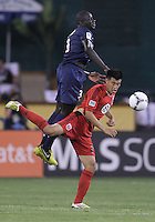 WASHINGTON, DC - July 28, 2012:  Long Tan (27) of DC United is beaten to a high ball by Mamadou Sakho (3) of PSG (Paris Saint-Germain) in an international friendly match at RFK Stadium in Washington DC on July 28. The game ended in a 1-1 tie.
