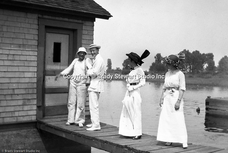 Erie PA:  Brady and Sarah Stewart along with her sister and husband, are all dressed up for lunch at the local fish restaurant - 1915.