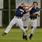Lake Oswego's Charlie Olson (8) attempts to pull in tough fly ball while colliding with teammate Zach Mandelblatt (4) who takes a glove to the face.