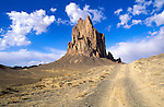 Afternoon light on Shiprock and dirt road, Navajo Indian Reservation, New Mexico USA