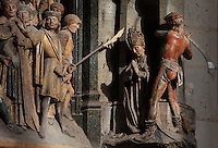 The beheading of St Firmin, Gothic style polychrome high-relief sculpture from the South side of the choir screen, 1490-1530, commissioned by canon Adrien de Henencourt, depicting the life of St Firmin, at the Basilique Cathedrale Notre-Dame d'Amiens or Cathedral Basilica of Our Lady of Amiens, built 1220-70 in Gothic style, Amiens, Picardy, France. St Firmin, 272-303 AD, was the first bishop of Amiens. Amiens Cathedral was listed as a UNESCO World Heritage Site in 1981. Picture by Manuel Cohen
