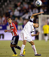 Real Salt Lake forward Alvaro Saborio (15-w) battles with Chivas USA defender Mariano Trujillo (8). Real Salt Lake defeated CD Chivas USA 2-1at Home Depot Center stadium in Carson, California on Saturday May 22, 2010.  .