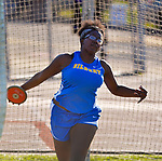 WINSTED, CT-041817JS09- Gilbert's Alexis Johnson-Blue competes in the discus during their meet with Litchfield and Lewis Mills  Tuesday at Northwest Regional High School in Winsted. <br /> Jim Shannon Republican-American