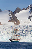 Tall ship in the icy waters of the Fuglesongen glacier, Svalbard.