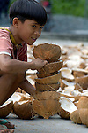 A boy in Katipunan, on the southern Philippine island of Mindanao, where many residents earn a living harvesting and processing coconuts.