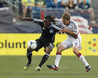 San Jose Earthquakes midfielder Walter Martinez (10) attempts to control the ball as New England Revolution midfielder Scott Caldwell (6) pressures. In a Major League Soccer (MLS) match, the New England Revolution (white) defeated San Jose Earthquakes (black), 2-0, at Gillette Stadium on July 6, 2013.