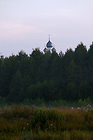 Novy Gorky, Ivanova Region, Russia, 05/08/2012..A Russian Orthodox church rises above the woods surrounding Novy Gorky, some 200 miles east of Moscow.