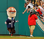 16 May 2012: Teddy Roosevelt, one of the Washington Nationals Racing Presidents, entertains fans between inning of a game against the Pittsburgh Pirates at Nationals Park in Washington, DC. The Racing Perogies joined the race as well. The Nationals defeated the Pirates 7-4 in the first game of their 2-game series. Mandatory Credit: Ed Wolfstein Photo