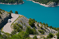 St Vincent les Forts, Lac de Serre Poncon, Alpes des Haute Provence, France, July 2013. The Hautes Alpes region is made of valleys, lakes, canyons and mountains going from the northern Alps to the Provence and ranges from 500m to 4302m  in altitude. Endowed with an exceptional beauty the Hautes Alpes has managed to keep clear of industry and large crowds. The atmosphere has stayed casual and convivial. There is an alpine feeling in this area due to its steep slopes and the abundance of mountain villages. Photo by Frits Meyst/Adventure4ever.com