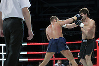 Moscow, Russia, 05/06/2010..Sergei Zimnevich punches Rafael Aliev in the face during a K-1 bout at the new Fight Nights boxing tournament, featuring kick-boxing, boxing and mixed fighting.