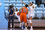 17 November 2015: Florida A&M's Khadejra Young (11) charges into North Carolina's Jamie Cherry (left) as North Carolina's Stephanie Watts (5) follows the play. The University of North Carolina Tar Heels hosted the Florida A&M University Rattlers at Carmichael Arena in Chapel Hill, North Carolina in a 2015-16 NCAA Division I Women's Basketball game. UNC won the game 94-58.
