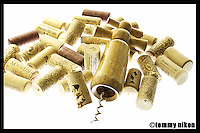 Wine corks and cork screw on light table