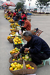 Asia, China, Yichang. Local farmers selling oranges in Yichang.