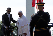 U.S. President Barack Obama (L) guides Pope Francis (C) to his chair during his arrival ceremony at the White House on September 23, 2015 in Washington, DC. The Pope begins his first trip to the United States at the White House followed by a visit to St. Matthew's Cathedral, and will then hold a Mass on the grounds of the Basilica of the National Shrine of the Immaculate Conception. <br /> Credit: Alex Wong / Pool via CNP