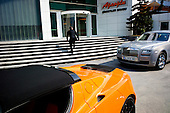 Istanbul, Turkey<br /> March 11, 2011<br /> <br /> Bounding up the stairway to his office building after leaving his Bentley and orange Tesla Roadster 2.5 Ali Ibrahim Agaoglu, age 56, is the chairman of 25-year-old Agaoglu Group, a builder of hotels, resorts, and ski lodges in Turkey; also one of Turkey's biggest housing providers. Even during 2009 downturn, was moving ahead with plans to eventually build 24,000 houses in four projects in Istanbul. Net worth according to Forbes Magazine on March 10, 2011 is $2 billion US; owns 90 million square feet of developable land on western coast of Turkey and continues to buy up parcels opportunistically. His Istanbul residential estate project called My City Bahcelievler sold 300 units in 3 days in mid-February. Announced plans to invest $2 billion in tourism projects including hotels and malls. Started working right after high school. Divorcee's so-called playboy antics with bikini-clad younger women closely tracked by local media. Hops around in his $4.5 million Bell 430 helicopter.  Passionate about luxury cars, has a Lamborghini, two Bentleys and a Ferrari California.