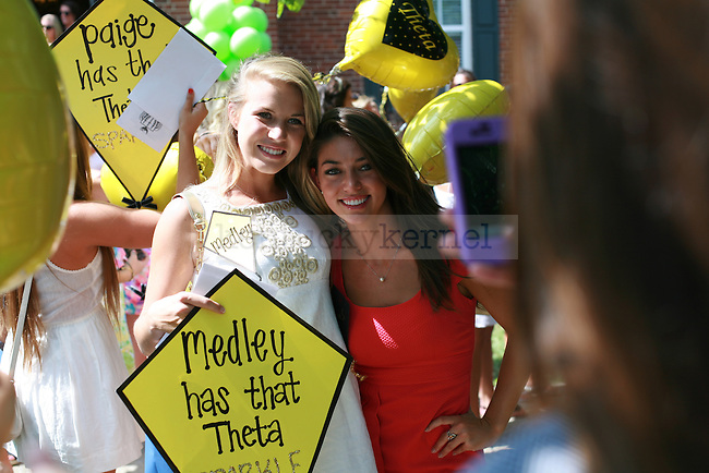 Kappa Alpha Theta sorority members pose for a cell phone photo during the 2011 sorority bid day event on Thursday, August 18, 2011.Photo by Brandon Goodwin | Staff