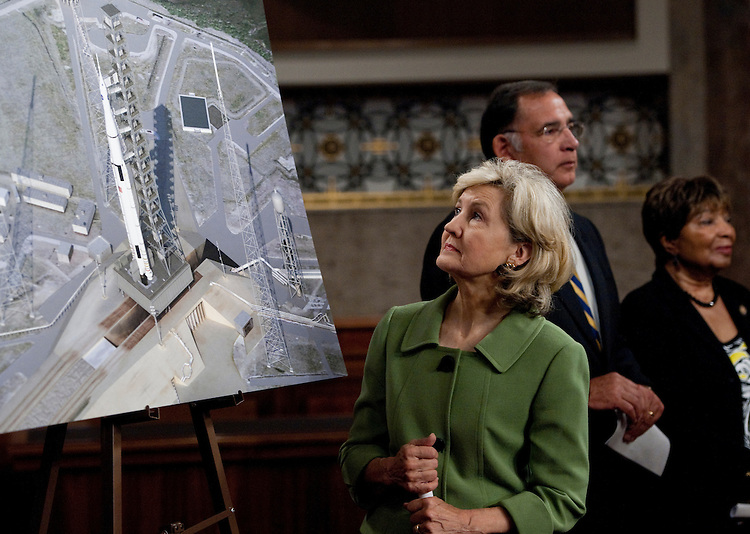 UNITED STATES - SEPTEMBER 14: Sen. Kay Bailey Hutchison, R-Texas, looks at an artist's rendering of the the Space Launch System  during the news conference to announce the design for NASA's next-generation rocket,  on Wednesday, Sept. 14, 2011. (Photo By Bill Clark/Roll Call)