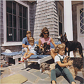 Hyannisport, MA - August 14, 1963 -- United States President John F. Kennedy, John F. Kennedy Jr.,  First Lady  Jacqueline Kennedy,  Caroline Kennedy.  Dogs: Clipper (standing), Charlie (with Caroline), Wolf (reclining), Shannon ( with John Jr. ), two of Pushinka's puppies (with Mrs. Kennedy).<br /> Credit: White House / CNP