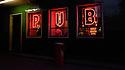 London, UK. 07.04.2015. Neon pub sign, London, UK.  Photograph © Jane Hobson.