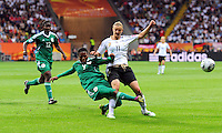 Alexandra Popp (r) of team Germany and Desire Oparanozie of team Nigeria during the FIFA Women's World Cup at the FIFA Stadium in Frankfurt, Germany on June 30th, 2011.