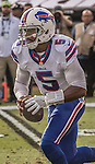 Buffalo Bills quarterback Tyrod Taylor (5) keep ball on Sunday, December 04, 2016, at O.co Coliseum in Oakland, California.  The Raiders defeated the Bills 38-24.