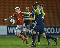 Blackpool's Mark Cullen battles with Stevenage's Jack King and Charlie Lee<br /> <br /> Photographer Alex Dodd/CameraSport<br /> <br /> The EFL Sky Bet League Two - Blackpool v Stevenage - Tuesday 14th March 2017 - Bloomfield Road - Blackpool<br /> <br /> World Copyright &copy; 2017 CameraSport. All rights reserved. 43 Linden Ave. Countesthorpe. Leicester. England. LE8 5PG - Tel: +44 (0) 116 277 4147 - admin@camerasport.com - www.camerasport.com