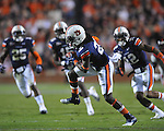 Auburn defensive back T'Sharvan Bell (22) intercepts an Ole Miss pass at Jordan-Hare Stadium in Auburn, Ala. on Saturday, October 29, 2011. .