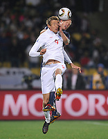Peter Crouch (9) of England and Jay DeMerit (back) of USA. USA tied England 1-1 in the 2010 FIFA World Cup at Royal Bafokeng Stadium in Rustenburg, South Africa on June 12, 2010.