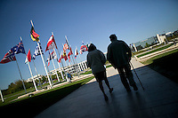 24 April 2004 - Caen, France - A couple of senior visitors exit the Memorial museum in Caen, France, 24 April 2004.