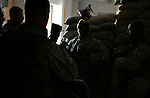 Surrounded by incoming Marines from 3rd Battalion 1st Marines (3/1) who will replace his unit, Sgt. LeDante Strickland (center) of the battered reserve 3rd Battalion 25th Marines (3/25) does his best to impart the knowledge and experience of he has gained while surviving seven months on the roadways of Western Iraq at his battalion's Firm Base 2 in Hit, Iraq on Tuesday September 12, 2005. The arriving 3/1 previously saw duty during the 2003 invasion and then again during the November 2004 assault on Fallujah.