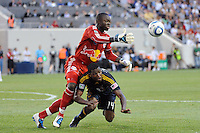New York Red Bulls goalkeeper Bouna Coundoul (18) goes over the top of Edson Buddle (14) of the Los Angeles Galaxy for a loose ball. The Los Angeles Galaxy defeated the New York Red Bulls 1-0 during a Major League Soccer (MLS) match at Red Bull Arena in Harrison, NJ, on August 14, 2010.