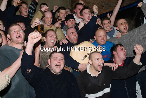 Shrove Tuesday Football. Atherstone Warwickshire UK 2008. Victors from The Angel Pub have their winners photo taken.