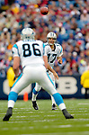 Carolina Panthers quarterback Jake Delhomme (17) passes to tight end Kris Mangum (86) for a gain against the Buffalo Bills on November 27, 2005 at Ralph Wilson Stadium in Orchard Park, NY. The Panthers defeated the Bills 13-9. Mandatory Photo Credit: Ed Wolfstein