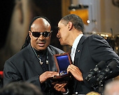 "Washington, D.C. - February 25, 2009 -- United States President Barack Obama presents the Library of Congress Gershwin Prize for Popular Song to Stevie Wonder as he and first lady Michelle Obama host ""Stevie Wonder In Performance at the White House: The Library of Congress Gershwin Prize"" in the East Room of the White House in Washington, D.C. on Wednesday, February 25, 2009..Credit: Ron Sachs / Pool via CNP"