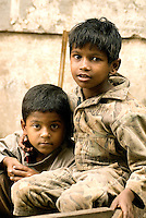 Two boys in the back streets of Kolkata in West Bengal. It is not know if these boys have a home nearby, but there are and estimated 50,000 children who live in the streets of Kolkata.