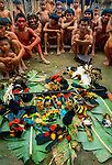 Yanomamo tribesmen with a selection of ceremonial objects, including monkey skills, toucan tail feathers, and the tails of monkeys.
