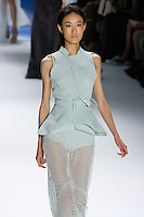 Shu Pei Qin walks runway in a Mint super pique tailored vest with double layer drawstring peplum over mint silk chiffon tank, and Mint eyelet drawstring sheer maxi skirt, by Vera Wang, for the Vera Wang Spring 2012 collection, during Mercedes-Benz Fashion Week Spring 2012.