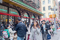 "Crowds outside the Häagen-Dazs  store in Chinatown in New York on their ""Free Cone Day"", Tuesday, May 10, 2016. Started by Reuben and Rose Mattus in 1960 the company is one of the first brands to create the market for premium ice cream. Häagen-Dazs is a brand of General Mills. (© Richard B. Levine)"