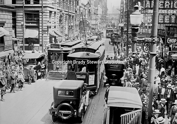 Pittsburgh PA: View of an old lantern slide created by Brady Stewart for the Pittsburgh Citizens Committee on City Plan (CCCP) when they were crafting the City Plan.  <br /> This view is of 5th Avenue at lunch time to highlight the need for a more efficient traffic pattern.<br /> The Citizen's Committee was organized to produce the Pittsburgh Plan for infrastructure including: playgrounds, major streets, Parks, Public Transit, Railroads and Waterways. Some of the cities most accomplished and influential citizens volunteered to serve on the various committees from 1920 thru 1924. Prominent citizens included: Richard and Andrew Mellon, Charles Armstrong, Henry Buhl Jr., Edgar, Issac &amp; Oliver Kaufmann, Roy A. Hunt, George Davison along with many leading Pittsburgh companies. They all paid an annual subscription (dues) to fund the activities of the Citizen's Committee. Brady Stewart provided photographic services for the committee.<br /> The negative and print were ordered by the Pittsburgh Regional Planning Association for a meeting in 1968.