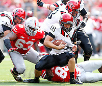 Ohio State Buckeyes defensive lineman Steve Miller (88) sacks San Diego State Aztecs quarterback Quinn Kaehler (18) during the 1st quarter of their college football game at Ohio Stadium in Columbus on September 7, 2013.  (Dispatch photo by Kyle Robertson)
