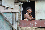 A woman in the window of her home in Batey Bombita, a community in the southwest of the Dominican Republic whose population is composed of Haitian immigrants and their descendents.