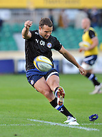 Olly Barkley practises his kicking during the pre-match warm-up. Aviva Premiership match, between Bath Rugby and Northampton Saints on September 14, 2012 at the Recreation Ground in Bath, England. Photo by: Patrick Khachfe / Onside Images