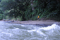 Travelling the jungles of the Rio Napo in eastern Ecuador by motorized canoe.