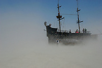 A Pirate boat in middle of a dust storm in Burning Man festival, Nevada, USA, September 3, 2005. .Born in Argentina, photographer Ivan Pisarenko in 2005  decided to ride his motorcycle across the American continent. While traveling Ivan is gathering an exceptional photographic document on the more diverse corners of the region. Archivolatino will publish several stories by this talented young photographer..Closer look at  Ivan's page www.americaendosruedas.com....