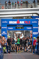 Heather Wurtele stands victorious at the Accenture Ironman California 70.3 in Oceanside, CA on March 29, 2014.