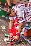 30 August 2015: Washington Nationals catcher Wilson Ramos adjusts his equipment in the dugout during a game against the Miami Marlins at Nationals Park in Washington, DC. The Nationals rallied to defeat the Marlins 7-4 in the third game of their 3-game weekend series. Mandatory Credit: Ed Wolfstein Photo *** RAW (NEF) Image File Available ***