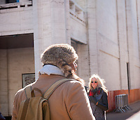 A fashionista dresses for the frigid weather wearing his Daniel Boone style coonskin hat outside the Fall 2015 Fashion Week shows in Lincoln Center in New York on Friday, February 13, 2015. The day started off in the single digits reaching the mid-teens and Sunday is expected to go down to zero, the coldest day in the city in 20 years. This is the last time the shows will be at Lincoln Center as they were booted after a lawsuit was won about them denying use of the park to the public. A new venue has not been determined yet. (© Richard B. Levine)