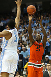 20 February 2016: Miami's Davon Reed (5) and North Carolina's Kennedy Meeks (3). The University of North Carolina Tar Heels hosted the University of Miami Hurricanes at the Dean E. Smith Center in Chapel Hill, North Carolina in a 2015-16 NCAA Division I Men's Basketball game. UNC won the game 96-71.