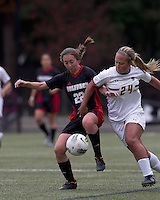 NC State defender Randi Soldat (22) attempts to control pass to Boston College forward/midfielder Rachel Davitt (24). Boston College defeated North Carolina State,1-0, on Newton Campus Field, on October 23, 2011.