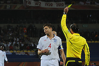 England captain Steven Gerrard receives a yellow card for dissent from Brazilian referee Carlos Simon. The U.S. and England played to a 1-1 draw in the opening match of Group C play at Rustenburg's Royal Bafokeng Stadium, Saturday, June 12th.